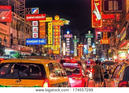 Chinatown Bangkok, Thailand - January  29, 2017 : China Town (Yaowarat) at night, Cars and shops on Road in the evening the main street of town