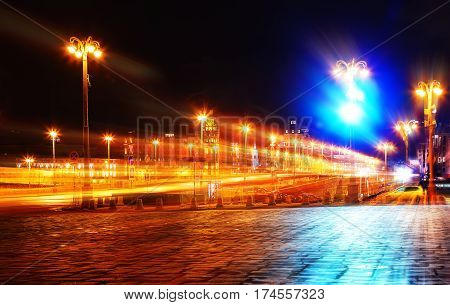 concept of night city street with a motion blur on the background of street lighting