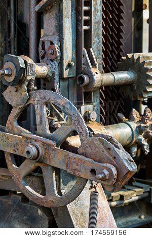 Vertical Sawing Machine. Rusty Mechanical Cutting Equipment.