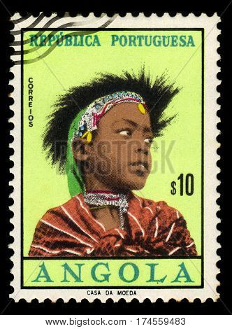 Portuguese Angola - CIRCA 1961: A stamp printed in Portugal shows woman coiffures of different angolan tribes, issued for use in Portuguese Angola, series girls of Angola, circa 1961