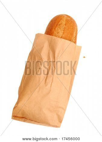 fresh bread in a paper bag over white background