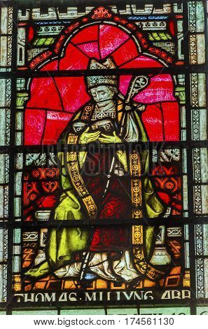 LONDON, ENGLAN - JANUARY 16, 2017 Saint Thomas Becket Archbishop Canterbury Stained Glass Chapter House Westminster Abbey London England. Becket was killed by King Henry II and became a Saint.