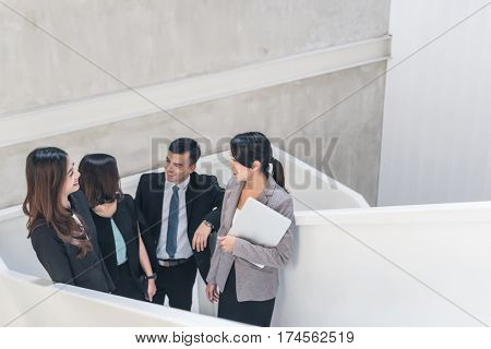 asian business group talk at the stairs