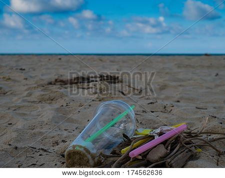 Garbage on the beach trash plastit bottle foam rubbish has pollute.selective focus