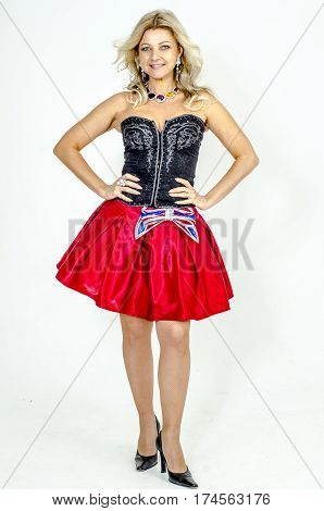A beautiful slender blonde girl in a corset and a bright skirt with a wide belt of actress