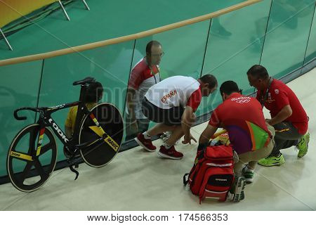 RIO DE JANEIRO, BRAZIL - AUGUST 13, 2016: Medics help cyclist Tania Calvo of Spain after her crash during Rio 2016 Olympics women's keirin first round heat 2 at the Rio Olympic Velodrome