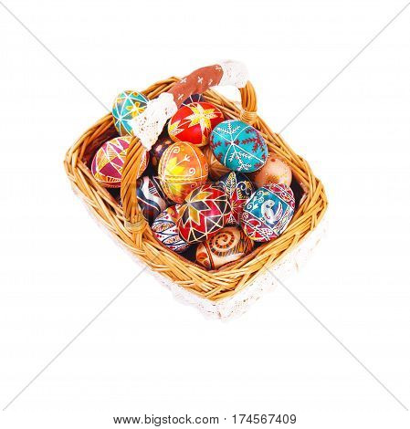Easter eggs in a basket isolated on a white background. Symbol of Christian holidays.