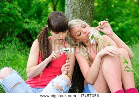 pretty girls fortune-telling on camomiles