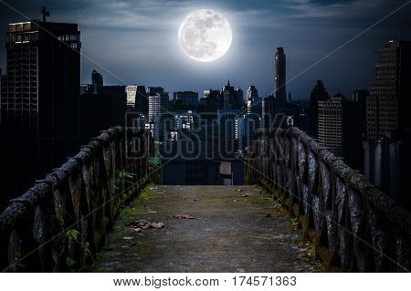 Old Concrete Bridge Across To Skyscrapers With Super Moon Background.
