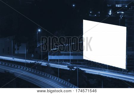 blank billboard for new advertisement at Motorway, Expressway in city at night, color tone effect.