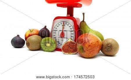 ripe fruit and kitchen scales on a white background. horizontal photo.