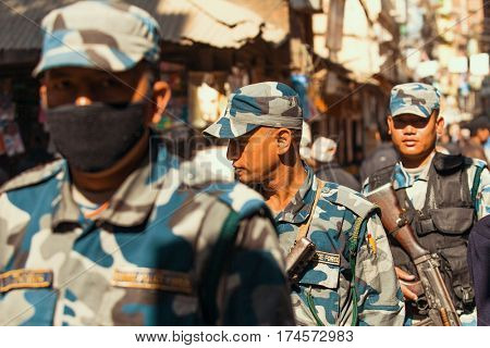KATHMANDU, NEPAL - NOV 29, 3013: Soldiers during protest within a campaign to end violence against women (VAW). Held annually since 1991, 16 days Nov 25 - Dec 10.