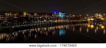 night view over river Meuse to Bonnefantenmuseum, Maastricht, Netherlands