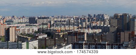 Panorama of a city block with high multi-storey apartment buildings the area of the big city from a height.