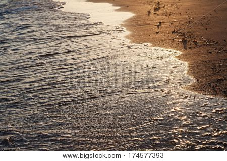 Shiny Tropic Sea Wave On Golden Beach Sand In Sunset Light