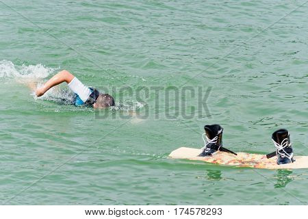 Male fall from wakeboard in lake, color image