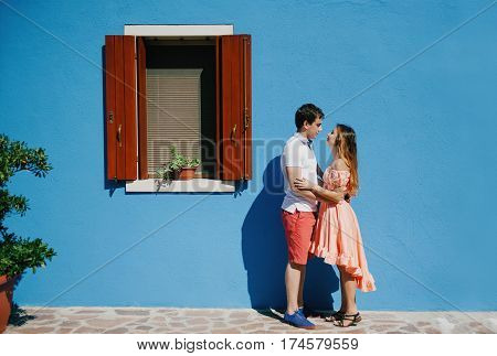 Young couple in a summer day in Burano Venice Italy Europe