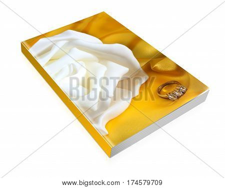 Book Of Wedding Rings On Yellow Fabric