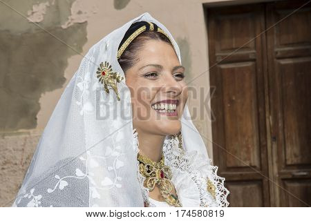 CAGLIARI, ITALY - MAY 1 2013: 357 Religious Procession of Sant'Efisio - portrait of a beautiful smiling woman in traditional Sardinian costume - Sardinia