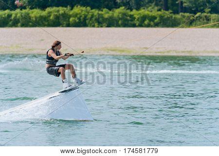 Cool Girl On Wakeboard Stunt Platform