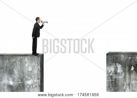 Man Using Speaker Yelling On High Concrete Wall