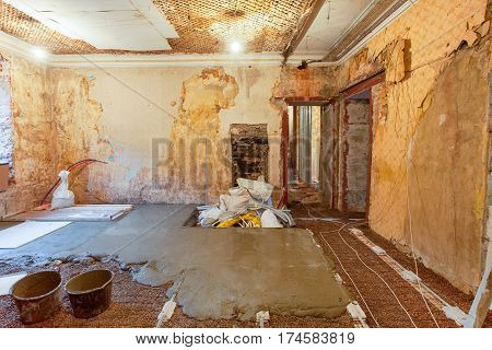 Interior of apartment during on the renovation and construction ( making a concrete floor)