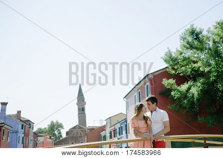 Young tender couple in Burano Venice Italy