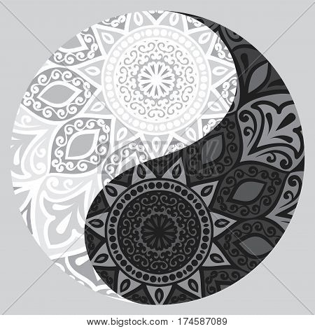 Drawing of a black and white mandala round ethnic ornament in shape of symbol yin yang