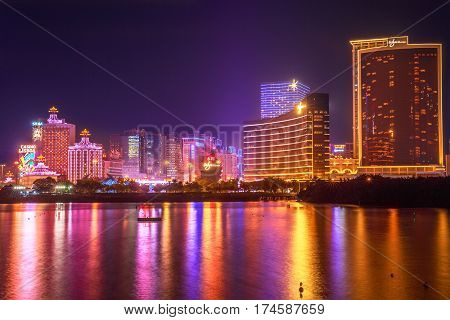 Macau, China - December 9, 2016: Cityscape with Wynn Macau, MGM Macauand Casino Lisboa, popular landmark reflecting in Nam Van Lake, a man-made lake in southern end of Macao Peninsula.