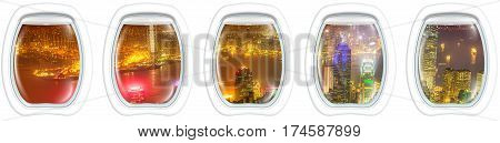 Aerial view of Hong Kong cityscape by night, from airplane portholes. Passenger panoramic point of view, isolated on white background, copy space. Concept of transport, travel, vacation and leisure.