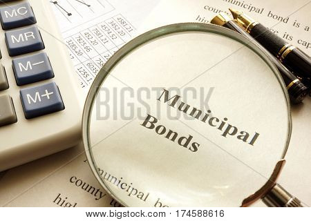 Document with title municipal bond on a table.