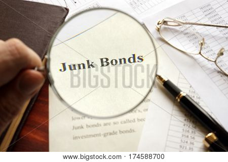 Document with title junk bond on a table. Selective focus.