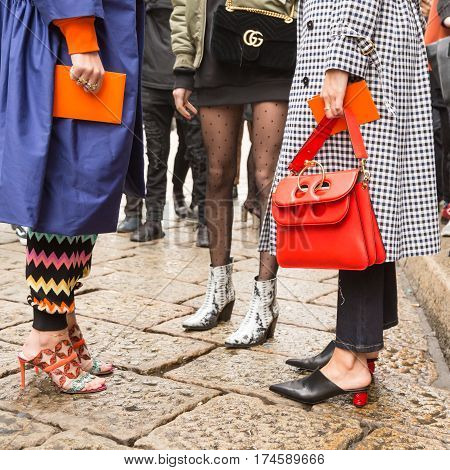 MILAN ITALY - FEBRUARY 24: Fashionable women pose outside Sportmax fashion show during Milan Women's Fashion Week on FEBRUARY 24 2017 in Milan.