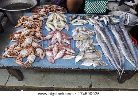 fresh fishes and crabs on indian market stall Tamil Nadu South India