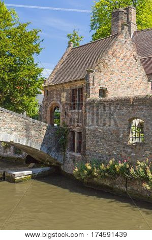 Famous medieval St Bonifacius Bridge in historic center of Bruges.(Belgium). Vertically.