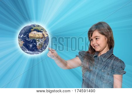 Smiling little girl is touching the Planet Earth All is on on the blue gradient background with light rays. Elements of this image furnished by National Aeronautics and Space Administration.