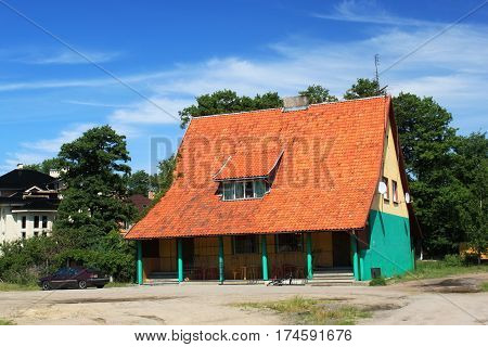 Old former german building in the Morskoe (Pillkoppen) village in the Curonian Spit National Park. Russia.