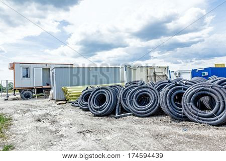 Makeshift storage material HDPE and PVC pipe for different usage at construction site in the improvised warehouse.