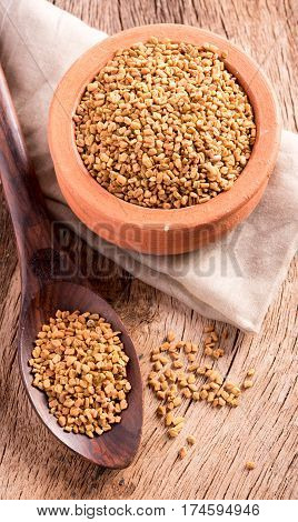 bowl of fenugreek on the wooden table
