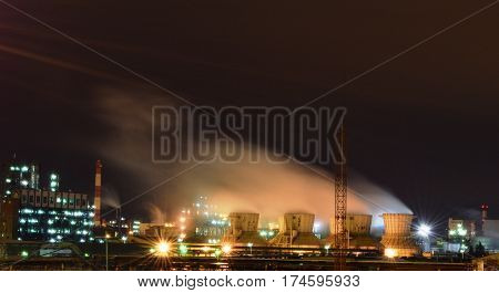 Industrial power plant with smokestacks and cooling towers in Kazan, Russia