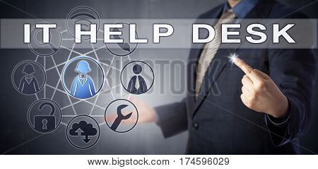 Businessman in steel blue suit is contacting IT HELP DESK for support via virtual touch. Information technology metaphor and business solutions concept for remote desktop assistance services.