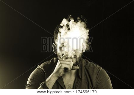 Man Smoking Cigar Surrounded By Smoke / Short Bearded Man With A Gangster Look Smoking Cigar Surroun