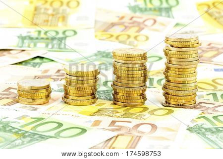 stack coins, upward curve
