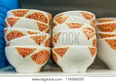 Close-up photo of many white tea cups