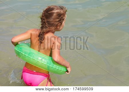 Little Girl Played In The Sea With Rubber Ring