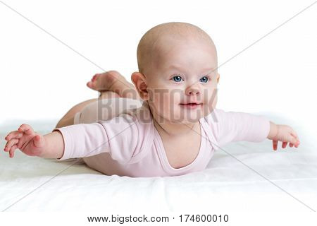 beautiful child baby lying on belly over white background
