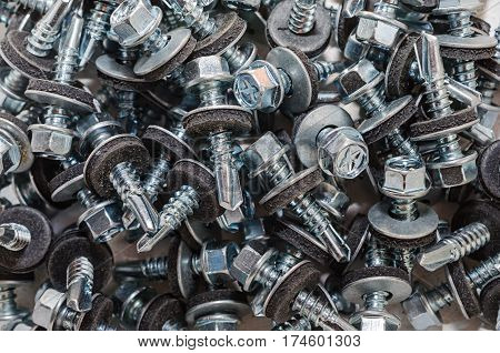 Nuts bolts screws closeup. Background for design