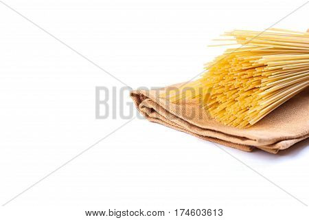 uncooked pasta on a cloth on a white background
