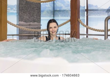 Beautiful woman relaxing in a hydro tub massage