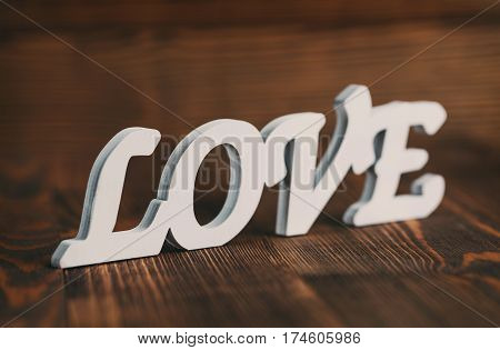 Love. Love wooden word with space for your text. Love wooden letters on rustic background, Love valentines day background,